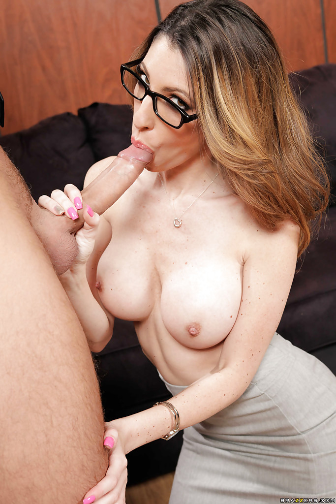 Big tit babe in glasses sucking a huge wiener and eating that cumshot