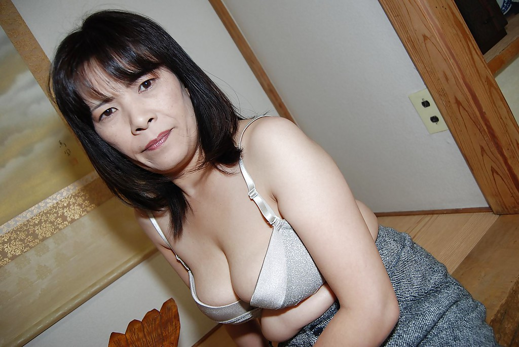 Asian Big Pussy Porn - ... Asian milf Yumiko undressing her big boobs and hairy pussy ...