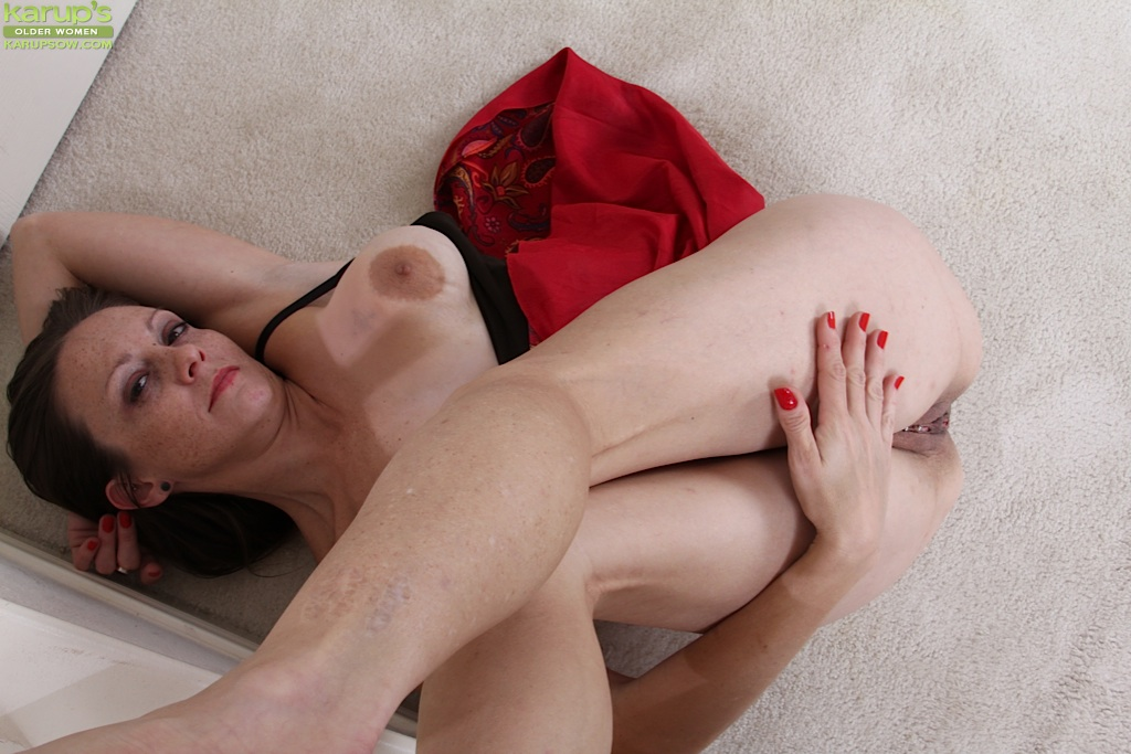 Smooth milf brunette Alexis is showing her big tits and shaved pussy