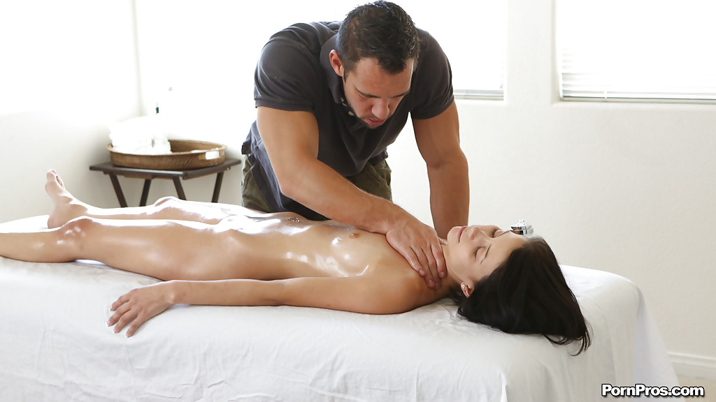 Awesome oiled up slut with shaved pussy Alana gets a sweet massage