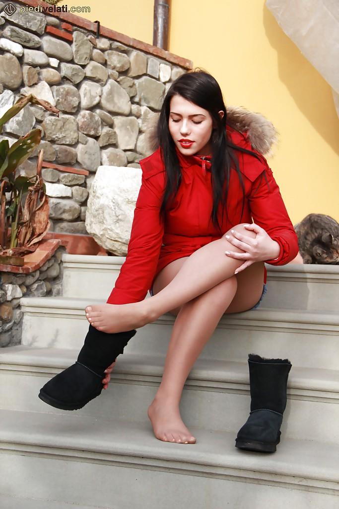 Brunette babe Petra showing her foot fetish passion and legs