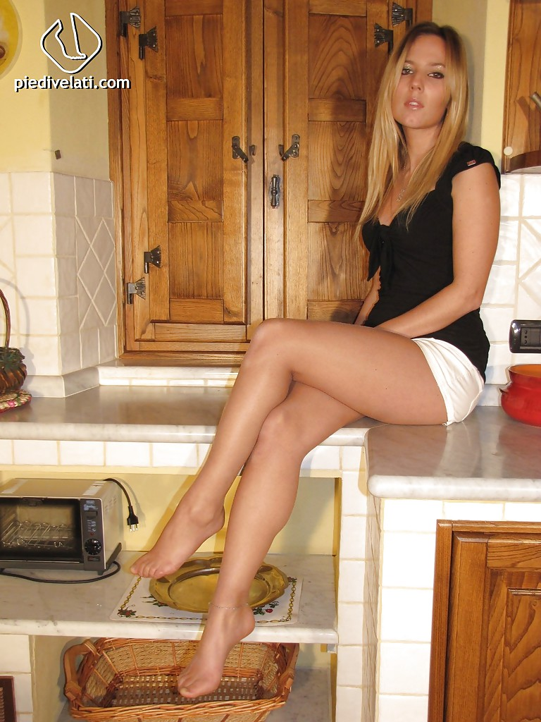 blonde whore with sexy legs selene is up for some foot fetish