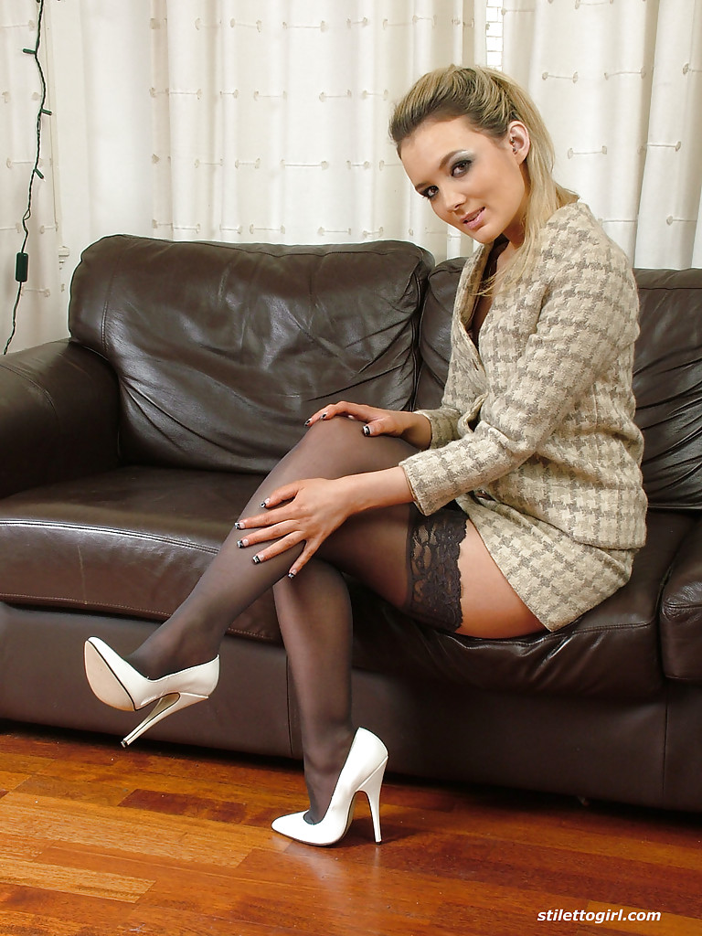 Brilliant chick with slim legs Faye Taylor showing her body in a skirt