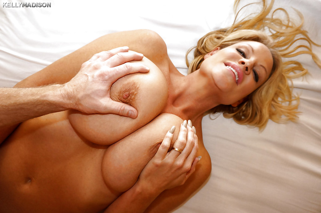 Kelly Madison is teasing her boyfriends hard cock while doing handjob