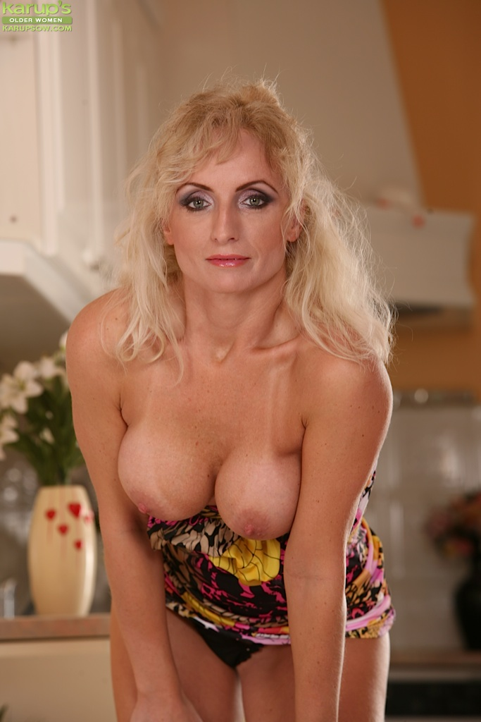 Blonde mature tit