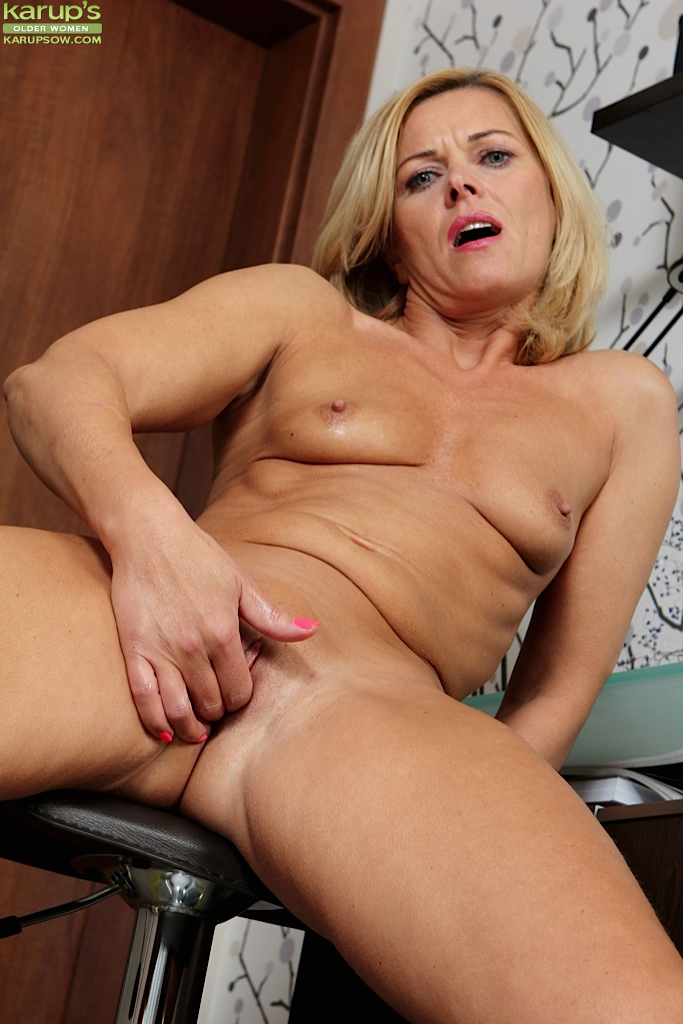 Lovely blonde mature masturbates