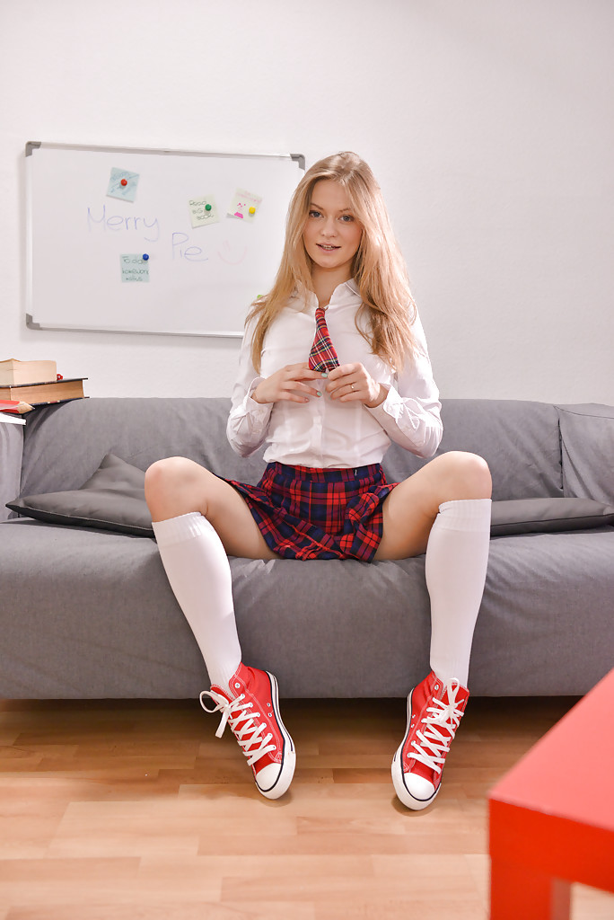Undressing session from a teen babe Merry Pie in a schoolgirl uniform