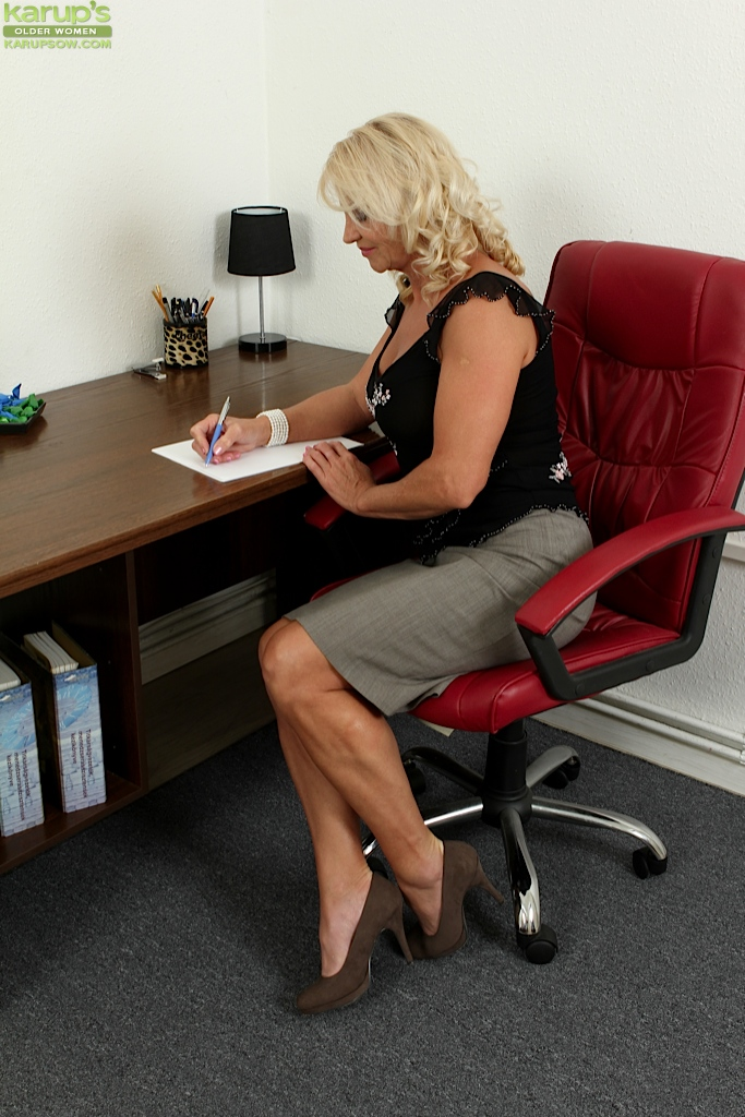 Mature big tits in office