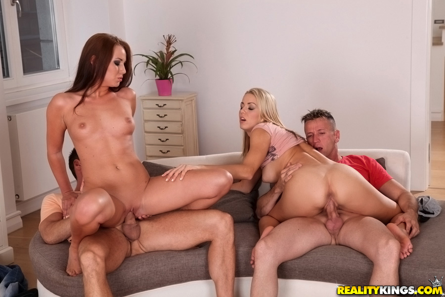 Two couples having sex together