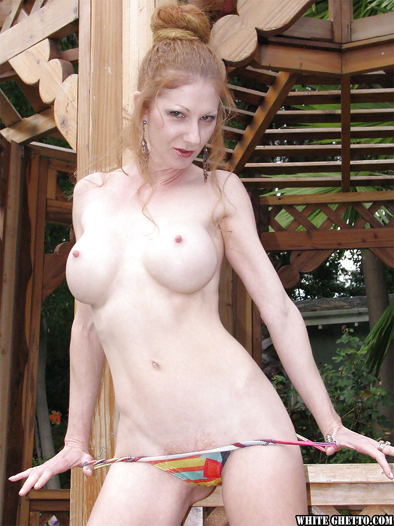 older naked women with bare breasts