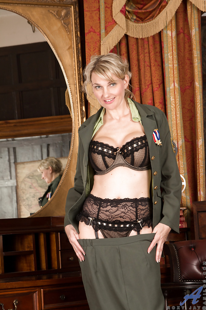 Beauty blonde Roxy Jay is taking off her nice military ...