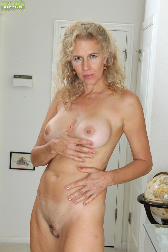 mature blonde with big boobies cally jo shows her hairy