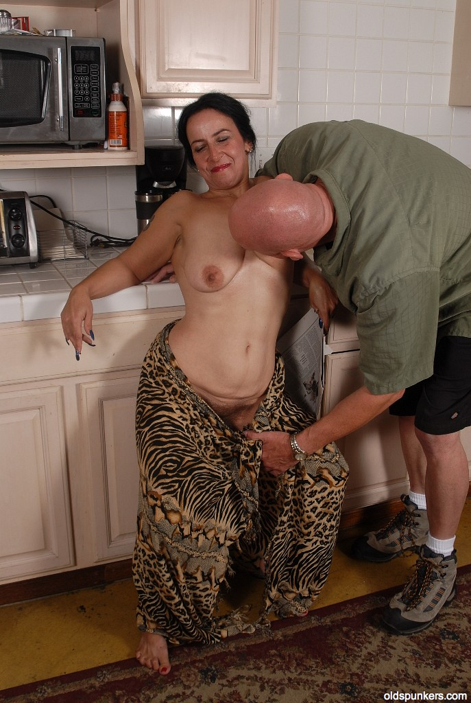 Mature brunette gets big one