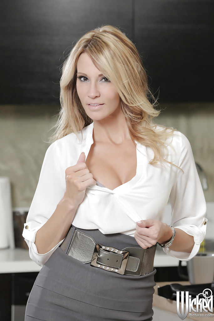 ... Milf blonde Jessica Drake takes off her tight skirt in the kitchen ...