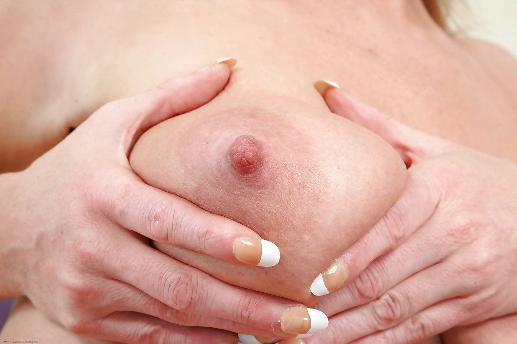 Busty blonde Jade shows off her stunning big boobies and asshole