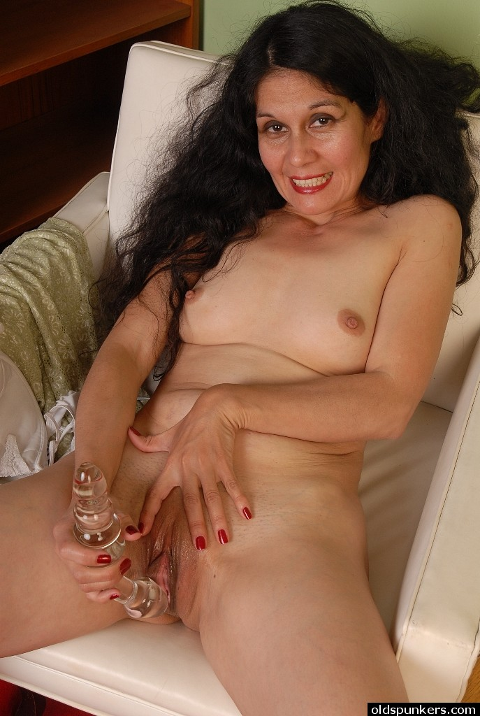 Busty latin playing with a robotic dildo