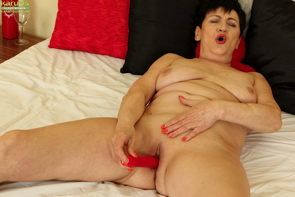 Fatty mature Karoline is playing with her lovely red sextoys