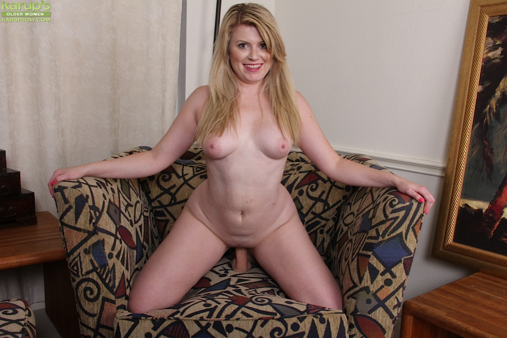 Mature blond sitting on a huge dildo