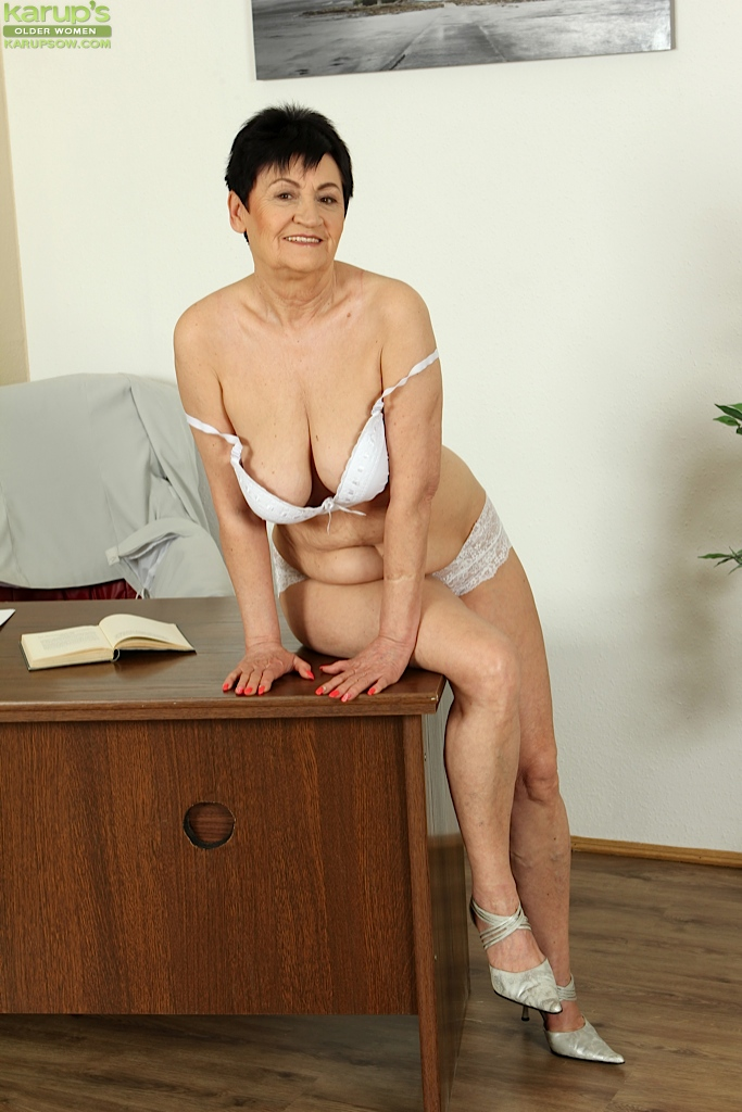 ... Mature and sexy office whore Karoline makes everybody see her old cunt  ...