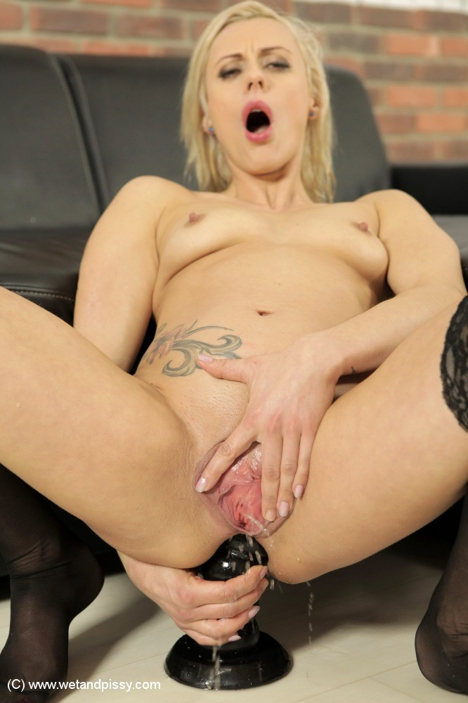 Blonde milf masturbating with dildo