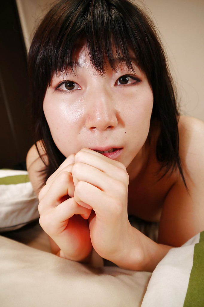 Asian mommy Aiko Kurita posing solo in white panties and skirt