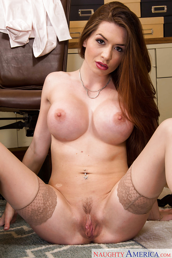Naughty big ass babe Veronica Vain posing in her office in stockings