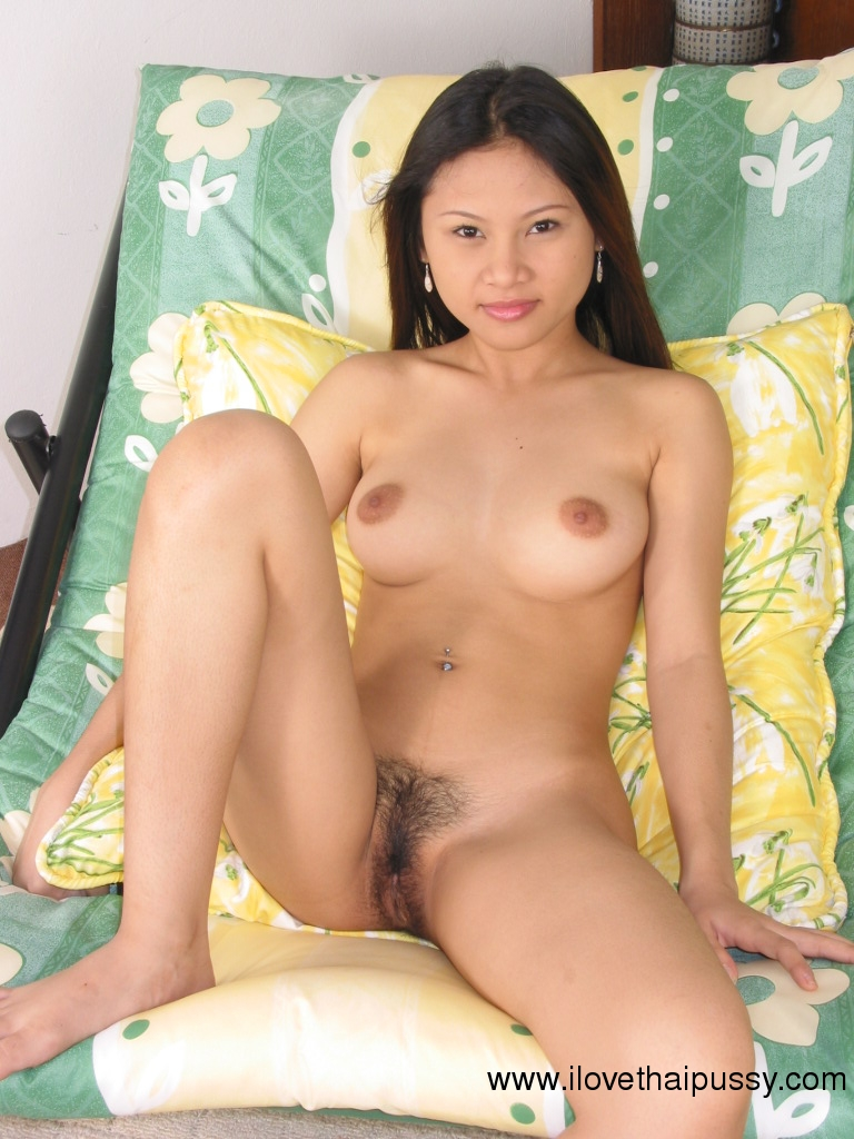 image Young beauty with hairy pussy climbs a treepee