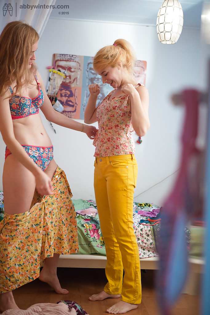 Splendid young lesbians Ashley L and Laney getting dressed after sex