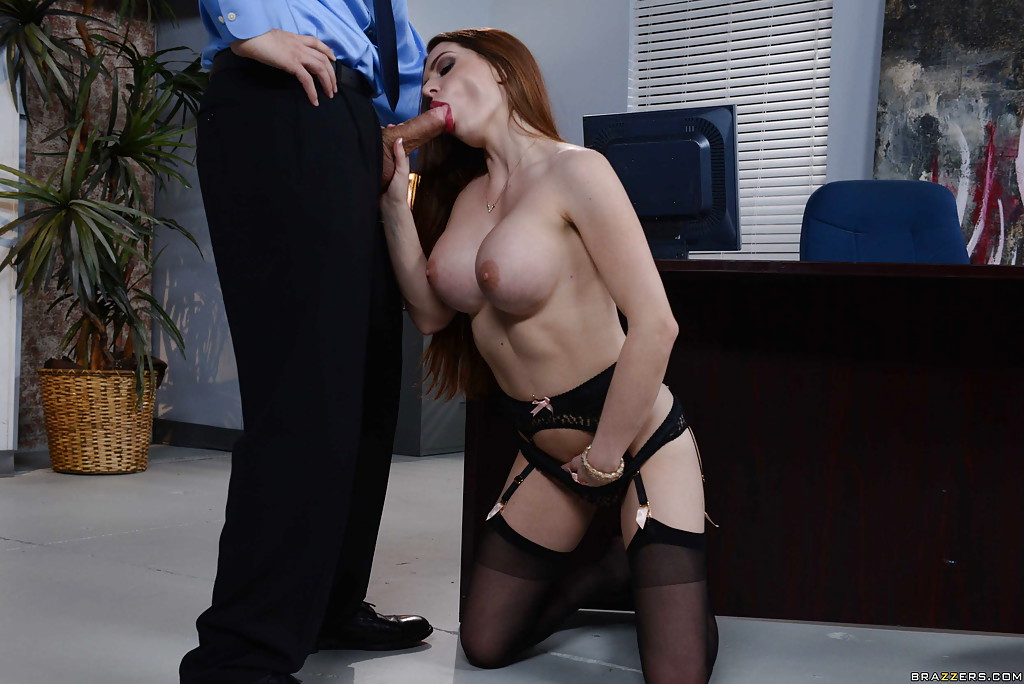 Bosomy secretary Veronica Rain gives stocking clad foot job to boss