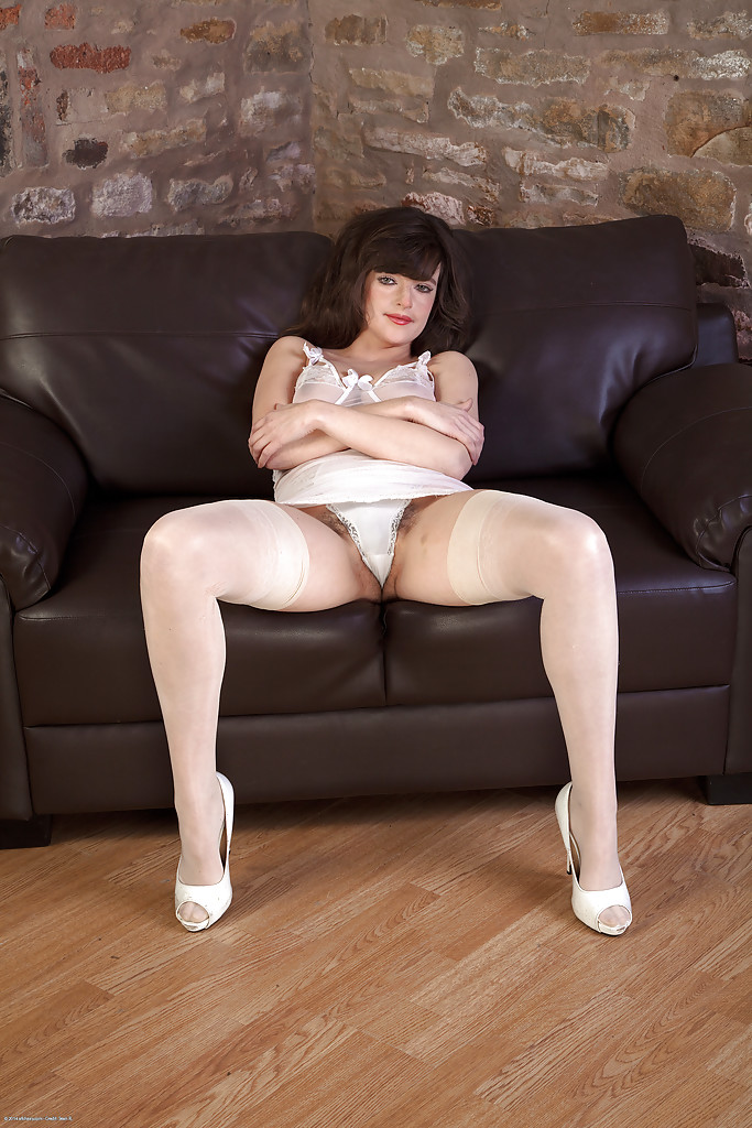 sexy mature mom katie posing solo on couch and spreading hairy pussy