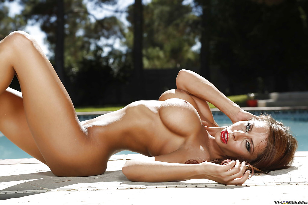 Busty centerfold model Madison Ivy posing outdoors in bikini and sunglasses