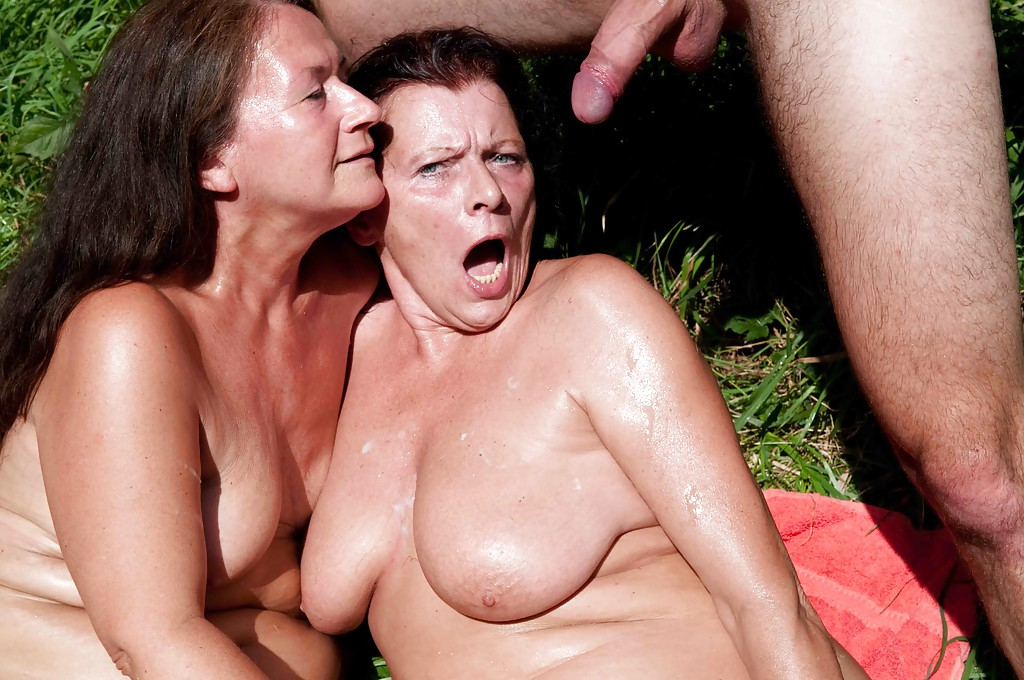 Two Busty Milfs Share Cock