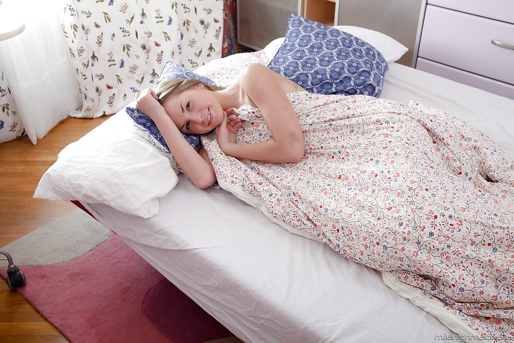 Innocent young girl with hard body photographed sleeping in bed