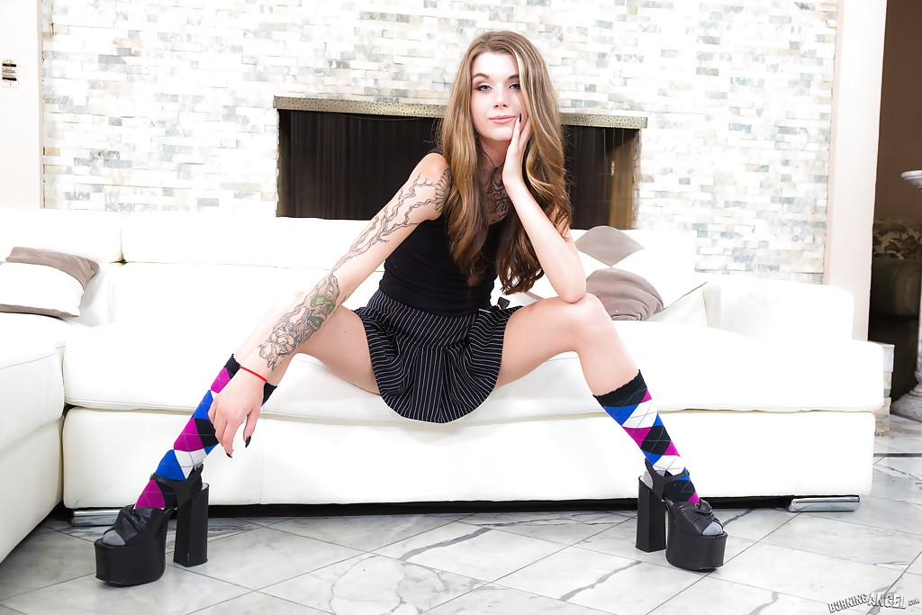 Tattooed beauty in socks showing off her amazing hairless pussy