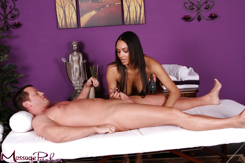 ... Ebony beauty Bethany Benz jerking off a cock at the local massage  parlour ...