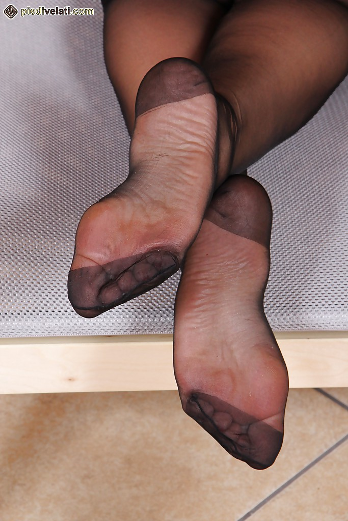 Nylon stocking footjob