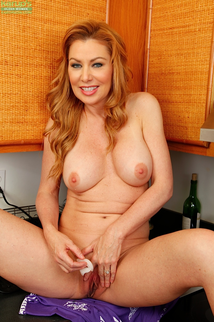 Mature masturbating in the kitchen