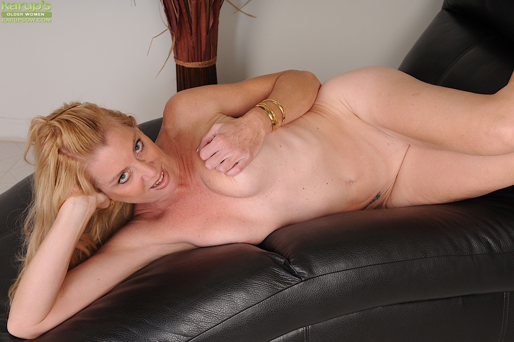 from Leroy girl posing naked on leather chair