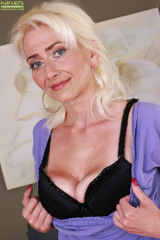 sexy over 50 blonde janotova baring small tits and shaved slit