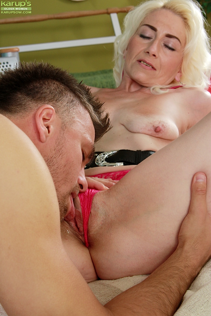 Fingering pussy of mature wife