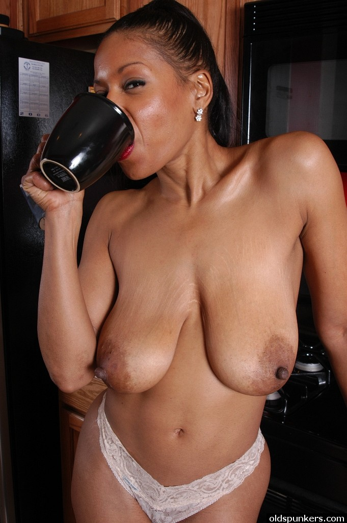 Black girl naked in kitchen