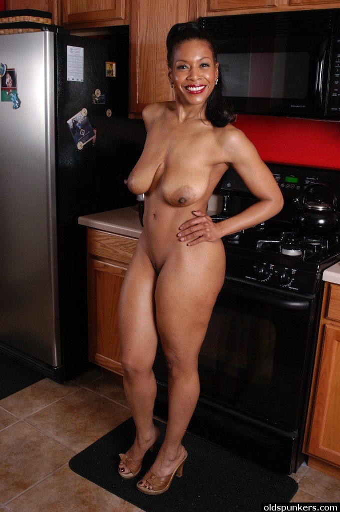 Not Naked mature women in kitchen