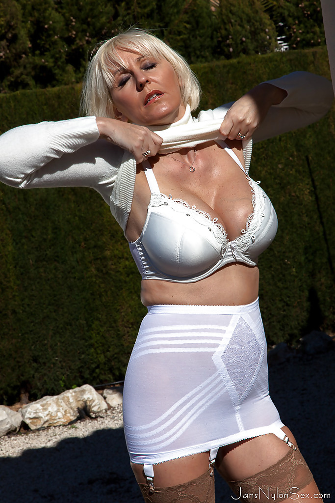 Buxom Mature Blonde Jan Burton Flashing Thigh And Garters