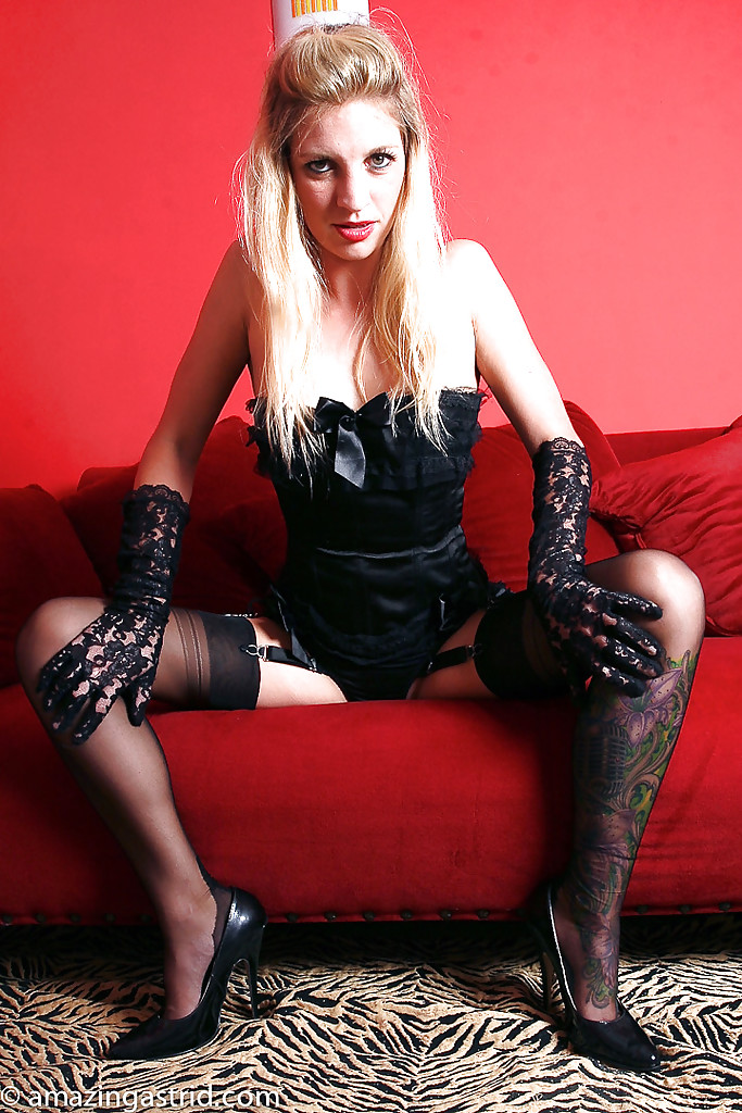 Trashy Blonde Wearing Sexy Neon Pink Stockings And Gloves