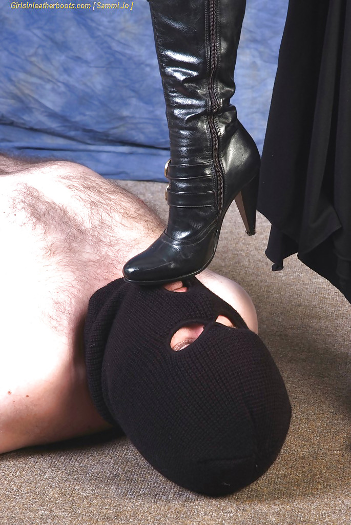hot chick in black boots face sitting masked man while