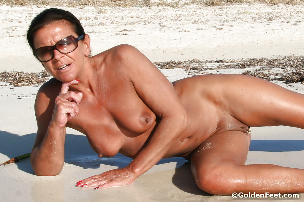 Mature nudes on a beach