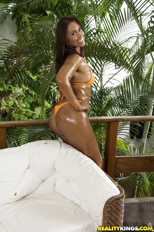 Oiled Brazilian beauty Cris Brasil letting tanned tits ...