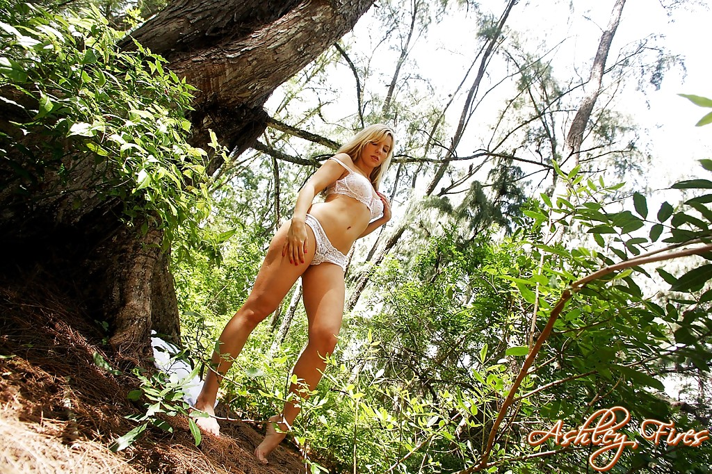 Beautiful blonde first timer Ashley Fires flashing upskirt panties in woods