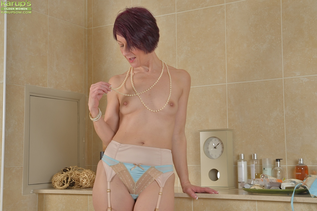 Mature lady brook playing with skeleton and her shaved pussy 5