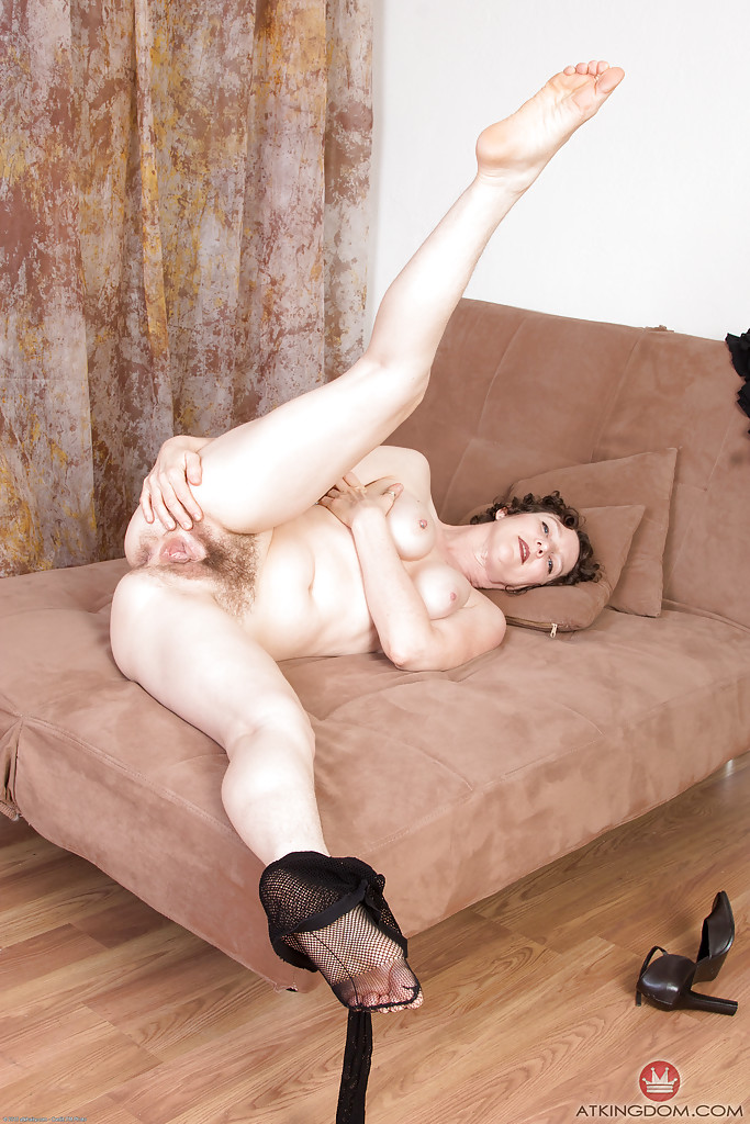 Older solo model Artimesia displaying hairy vagina underneath fishnets